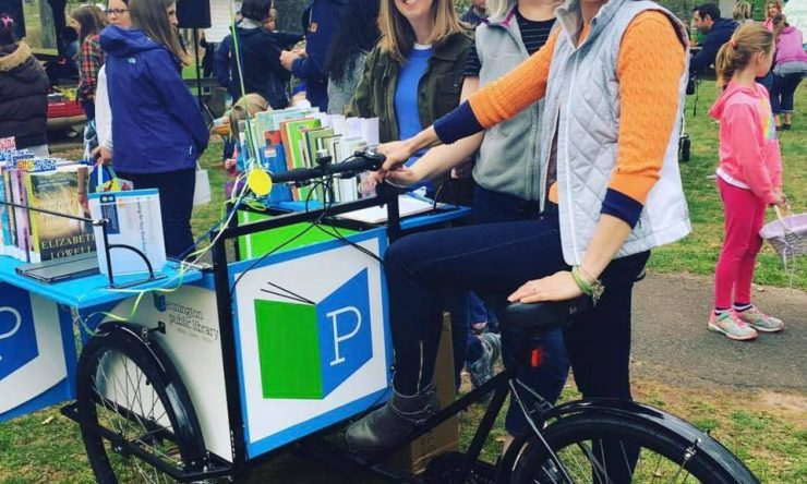 Kristin Tunkel, Sarah Murray, and Dawn Berman show off the Library's new Book Bike